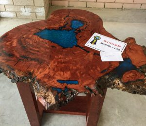 Burl and resin hardwood table.