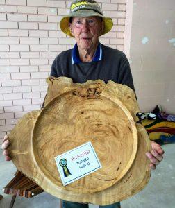 Winner holding woodwork.