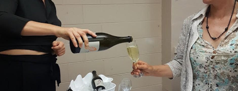 Wheelers serving wine